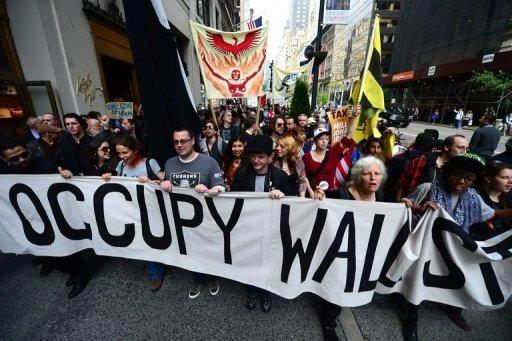 Occupy Wall Street participants march down Fifth Avenue as part of May Day events in New York in 2012