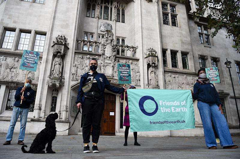 Friends of the Earth campaigners, pictured here outside the Royal Courts of Justice, London. (Photo: Kirsty O'Connor - PA Images via Getty Images)