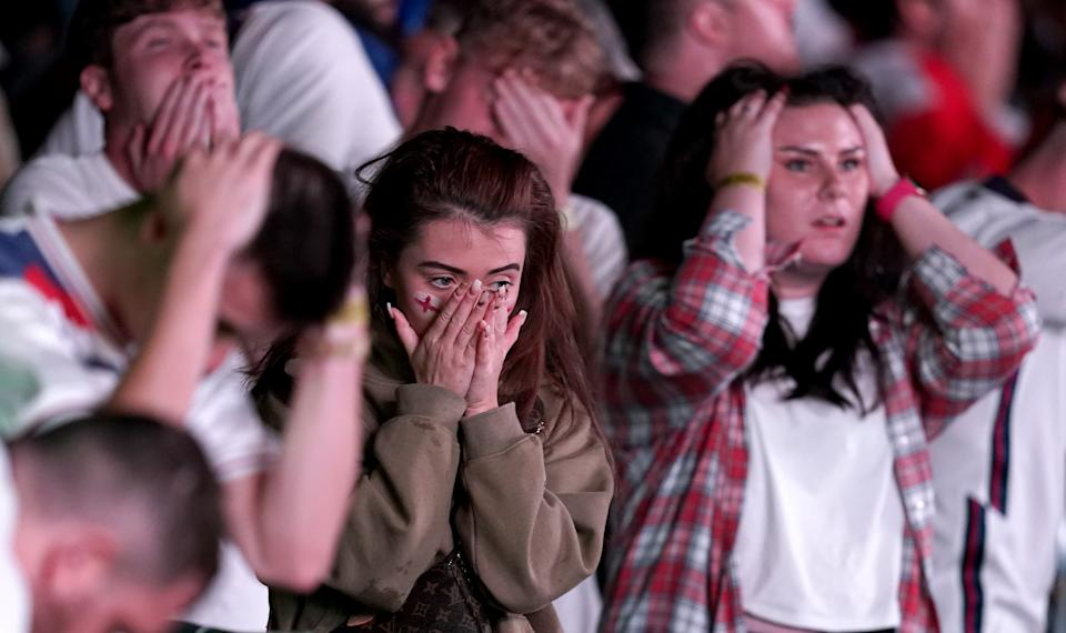 England fans are dejected after England lose the game on penalties at the fan zone in Trafford Park, Manchester as they watch the UEFA Euro 2020 Final between Italy and England. Picture date: Sunday July 11, 2021.
