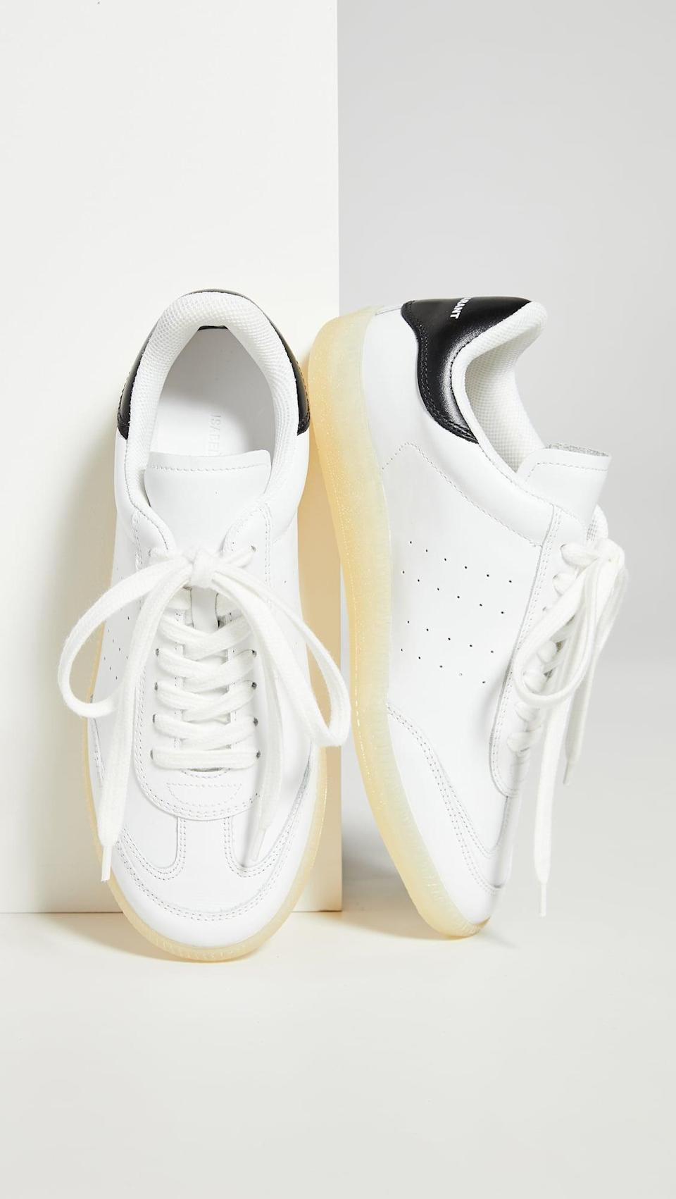 "<p><a href=""https://www.popsugar.com/buy/Isabel-Marant-Bryvee-Sneakers-563800?p_name=Isabel%20Marant%20Bryvee%20Sneakers&retailer=shopbop.com&pid=563800&price=460&evar1=fab%3Aus&evar9=44311634&evar98=https%3A%2F%2Fwww.popsugar.com%2Ffashion%2Fphoto-gallery%2F44311634%2Fimage%2F46921957%2FIsabel-Marant-Bryvee-Sneakers&list1=shopping%2Cshoes%2Csneakers%2Choliday%2Cgift%20guide%2Ceditors%20pick%2Cfashion%20gifts%2Cgifts%20for%20women&prop13=api&pdata=1"" class=""link rapid-noclick-resp"" rel=""nofollow noopener"" target=""_blank"" data-ylk=""slk:Isabel Marant Bryvee Sneakers"">Isabel Marant Bryvee Sneakers</a> ($460)</p> <p>""I'm always looking for a basic sneaker that doesn't feel basic. Read: it goes with everything (dresses, jumpsuits, skirts) but has some personality. This season, I'm all about Isabel Marant's sporty-cum-chic take on the everyday shoe."" - Hannah Weil McKinley, director, Fashion and Shop</p>"