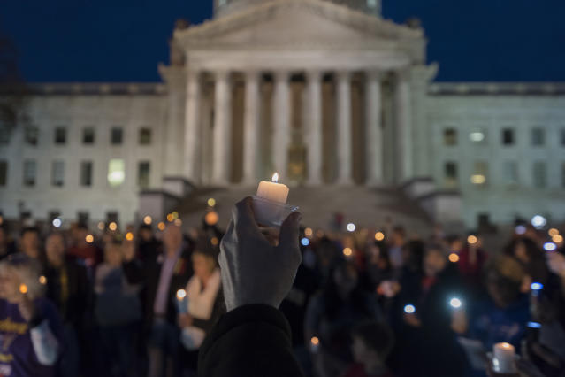 <p>Hundreds attend a candlelight rally in support of the ongoing statewide teachers walkout outside of the capitol building in Charleston, W.V., on Sunday, Feb. 25, 2018. (Photo: Craig Hudson/Charleston Gazette-Mail via AP) </p>