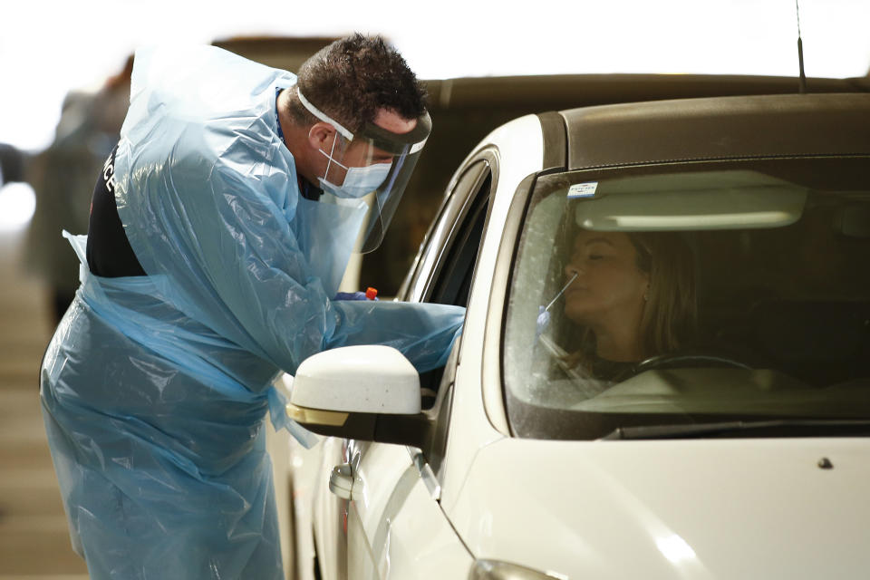 A woman is tested for coronavirus from her car in Chadstone. Source: AAP