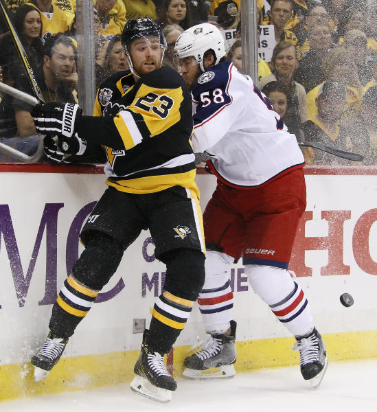 Columbus Blue Jackets' David Savard (58) collides with Pittsburgh Penguins' Scott Wilson (23) during the second period in Game 5 of an NHL first-round hockey playoff series in Pittsburgh, Thursday, April 20, 2017. (AP Photo/Gene J. Puskar)