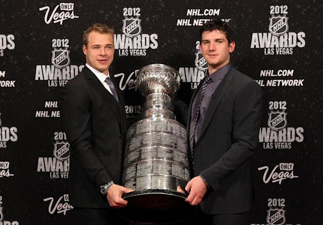 LAS VEGAS, NV - JUNE 20: Dustin Brown and Jonathan Quick of the Los Angeles Kings pose with the Stanley Cup as he arrives before the 2012 NHL Awards at the Encore Theater at the Wynn Las Vegas on June 20, 2012 in Las Vegas, Nevada. (Photo by Bruce Bennett/Getty Images)