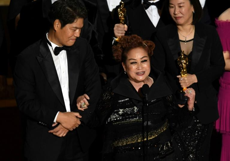 Executive producers Min Heoi Heo and Miky Lee (C) accepted the Best Picture award for 'Parasite' at the 2020 Oscars