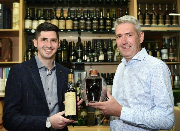 Harrison and Wayne Ormerod of Whisky Online Auctions with their record breaking bottle of whisky (Blackpool Gazette/SWNS)