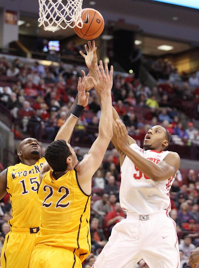 Ohio State's Trey McDonald (55) puts up a shot against Wyoming's Larry Nance, Jr. (22) and Jerron Granberry (15) during the first half of an NCAA college basketball game, Monday, Nov. 25, 2013, in Columbus, Ohio. (AP Photo/Mike Munden)