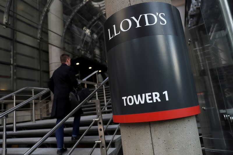 FILE PHOTO: A worker enters the Lloyd's of London building in the City of London financial district