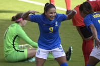 Brazil forward Debinha (9) celebrates after scoring a goal past Canada goalkeeper Stephanie Labbe (1) during the first half of a SheBelieves Cup women's soccer match, Wednesday, Feb. 24, 2021, in Orlando, Fla. (AP Photo/Phelan M. Ebenhack)