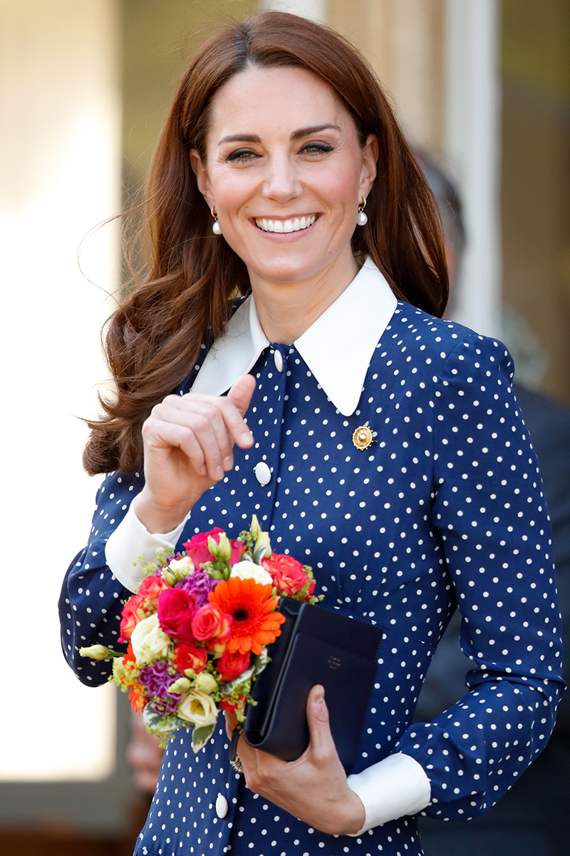 <p>Then, in May 2019, Kate donned an updated version of the dress featuring a higher collar and white cuffs at Bletchley Park. The resemblance is uncanny, no?</p>