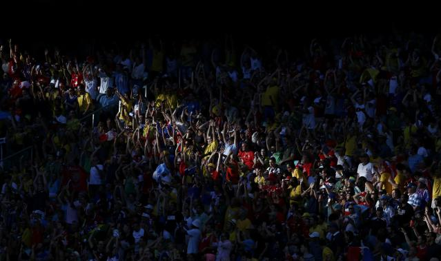 Fans wave during the 2014 World Cup Group E soccer match between Switzerland and France at the Fonte Nova arena in Salvador June 20, 2014. REUTERS/Marcos Brindicci (BRAZIL - Tags: SOCCER SPORT WORLD CUP TPX IMAGES OF THE DAY)