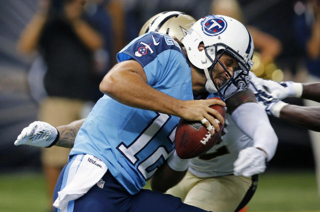 Tennessee Titans quarterback Charlie Whitehurst (12) is sacked by New Orleans Saints strong safety Kenny Vaccaro in the first half of a NFL preseason football game in New Orleans, Friday, Aug. 15, 2014. (AP Photo/Bill Haber)