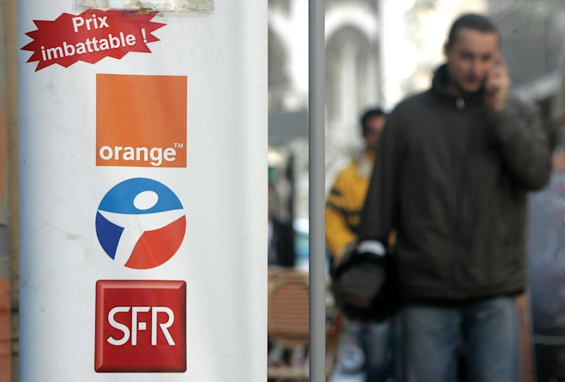 FILE - This Dec. 1, 2005, file photo shows three logos of French mobile operators : SFR, Bouygues and Orange, displayed at the entrance of a telephone store in Nice, southern France. French conglomerate Bouygues is offering euro10.5 billion ($14.4 billion) for control of mobile operator SFR telecommunications, entering a bidding war for the Vivendi unit. Bouygues said Thursday its offer to combine SFR with Bouygues Telecom would create a new number one mobile operator in France, leapfrogging current market leader Orange. (AP Photo/Lionel Cironneau, File)