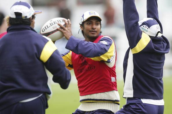 WELLINGTON, NEW ZEALAND - DECEMBER 17:  Kumar Sangakkara of Sri Lanka plays rugby as part of the team warm ups during the rain delay on day three of the second test match between New Zealand and Sri Lanka at the Basin Reserve December 17, 2006 in Wellington, New Zealand.  (Photo by Marty Melville/Getty Images)