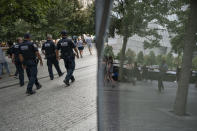 """NYPD officer Michael Dougherty, a 25-year veteran, patrols with his colleagues at the National September 11 Memorial & Museum where names of his deceased colleagues and friends are displayed, Monday, Aug. 16, 2021, in New York. """"Sometimes something will just hit me, just staring out at the plaza,"""" said Dougherty. """"I'll take a couple of minutes to compose myself. But it's still an emotional attachment. You know, I lost many friends that day. Hopefully people never forget that motto, 'Never forget.'"""" (AP Photo/John Minchillo)"""