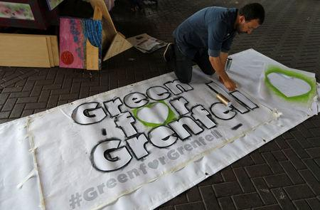 A banner to be attached to a float in the forthcoming Notting Hill Carnival is prepared near the Grenfell Tower in London, Britain August 25, 2017.  REUTERS/Peter Nicholls