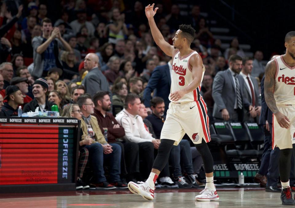 Portland Trail Blazers guard CJ McCollum gestures after scoring against the Golden State Warriors during the second half of an NBA basketball game in Portland, Ore., Wednesday, Dec. 18, 2019. The Trail Blazers won 122-112. (AP Photo/Craig Mitchelldyer)