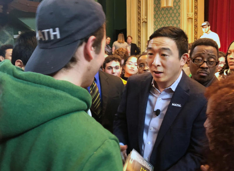 In this Dec. 5, 2019, photo Democratic presidential candidate Andrew Yang greets supporters at a campaign event at the University of Chicago in Chicago. Of all the Democrats in the wide field running for president, Andrew Yang is having the most fun. Unburdened by expectations and untethered to political convention, the tech entrepreneur has spent months cruising around the country, delivering dark warnings about America's new tech economy with an odd mix of millennial humor and bite. (AP Photo/ Sara Burnett)