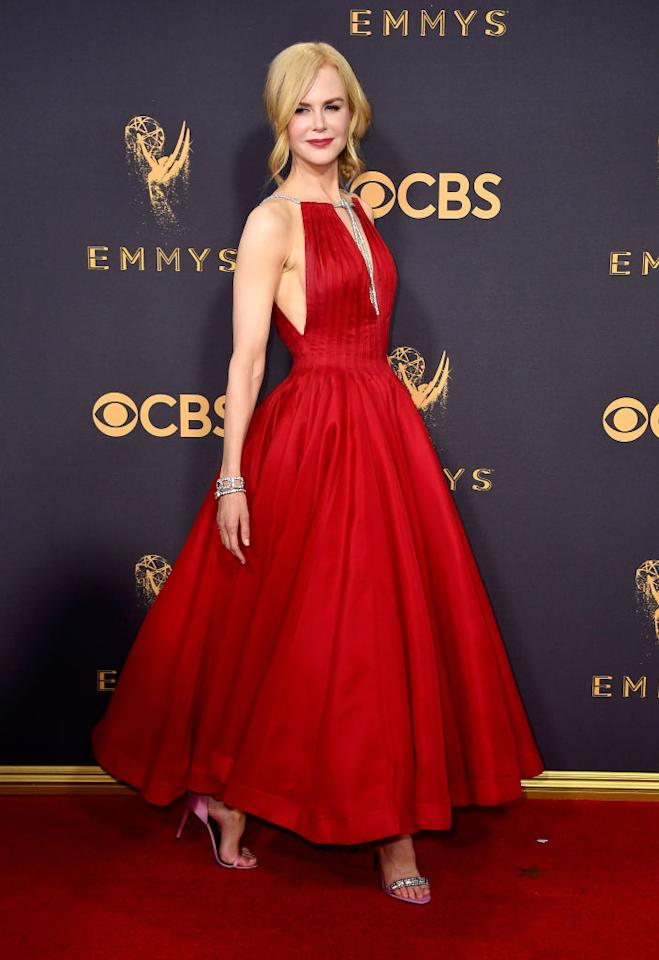 <p>Nicole Kidman, 50, was one of the best dressed of the night in a vibrant red pleated dress by Calvin Klein.<br /><i>[Photo: Getty]</i> </p>