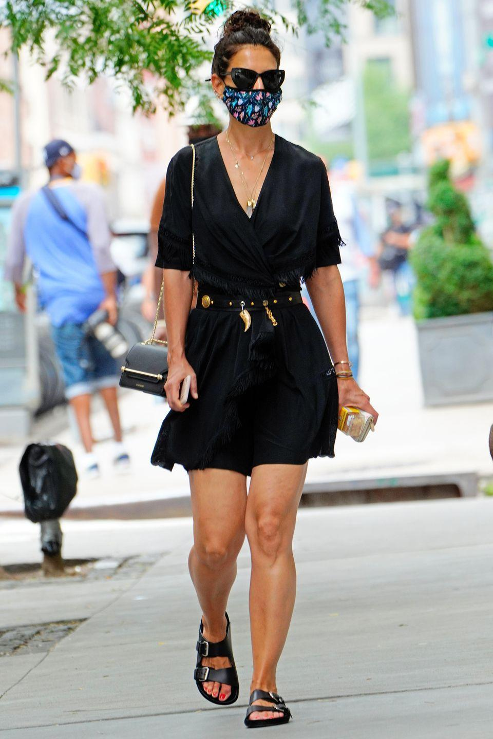 <p><strong>15 July </strong>Katie Holmes dressed for summer in a casual black dress and buckled sandals.</p>