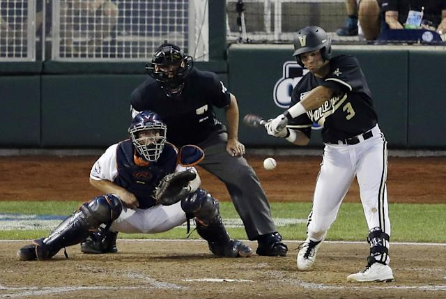 Vanderbilt shortstop Vince Conde hits an RBI single against Virginia in the sixth inning of the last game of the best-of-three NCAA baseball College World Series finals, in Omaha, Neb., Wednesday, June 25, 2014. (AP Photo/Nati Harnik)