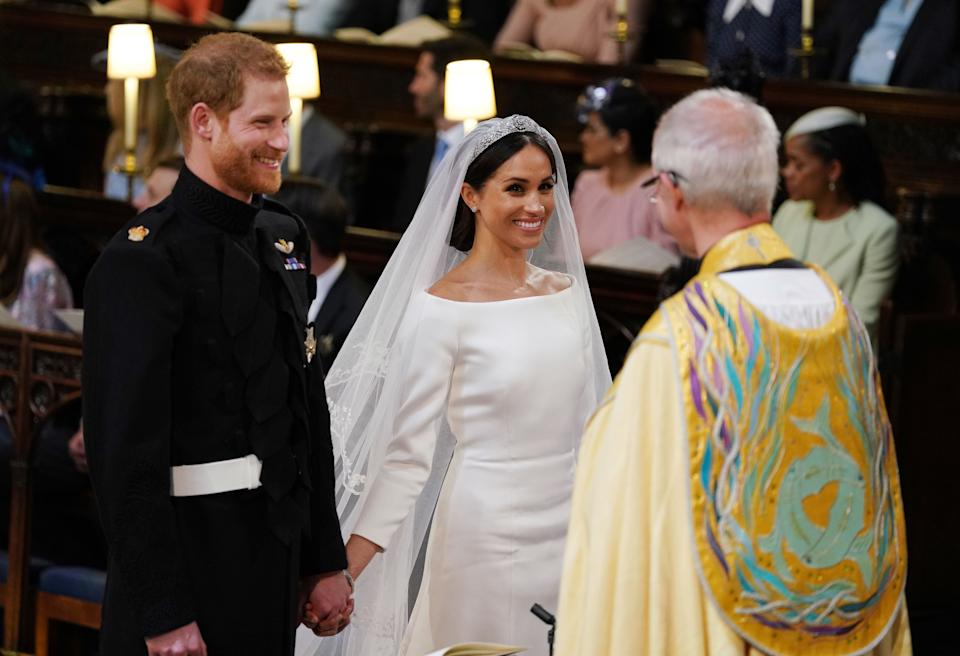 Prince Harry and Meghan Markle during their wedding service, conducted by the Archbishop of Canterbury Justin Welby in St George's Chapel at Windsor Castle on May 19, 2018 in Windsor, England