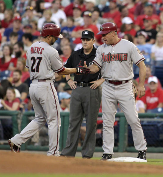Arizona Diamondbacks' Wil Nieves, left, celebrates with first base coach Steve Sax after hitting a one run single against the Philadelphia Phillies in the first inning of a baseball game, Saturday, Aug. 24, 2013, in Philadelphia. (AP Photo/H. Rumph Jr)