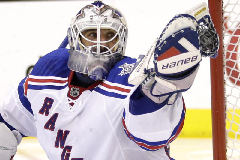 New York Rangers goalie Henrik Lundqvist, of Sweden, gloves the puck while playing the Los Angeles Kings during the second period in Game 5 of the NHL Stanley Cup Final series Friday, June 13, 2014, in Los Angeles. (AP Photo/Jae C. Hong)