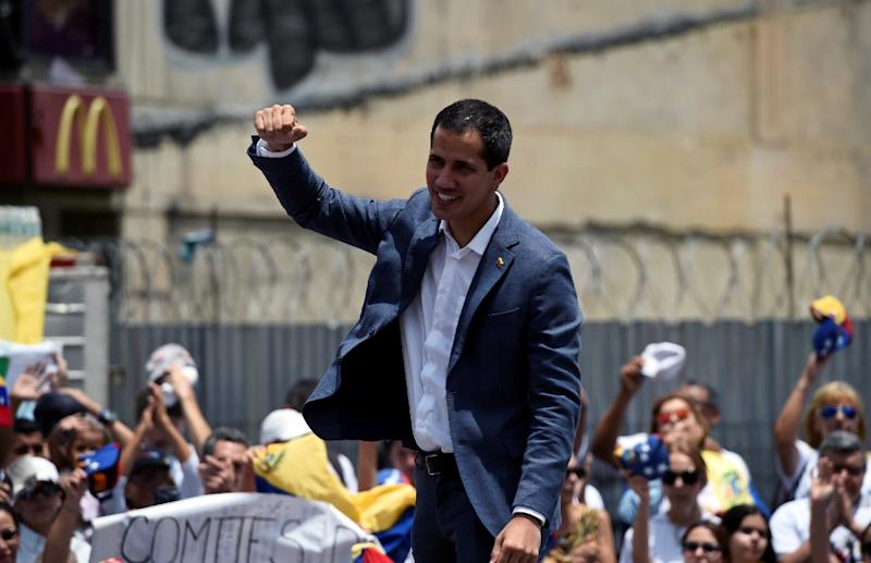 Venezuelan opposition leader Juan Guaido addresses supporters in Caracas on April 27, 2019 (AFP Photo/Federico Parra                      )