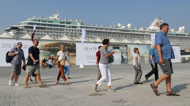 Tourists disembark at Doha Port as a new cruise season kicks off with the launch of a new temporary passenger terminal as Qatar works to increase the number of cruise ships making calls in the Gulf state (AFP Photo/KARIM JAAFAR)