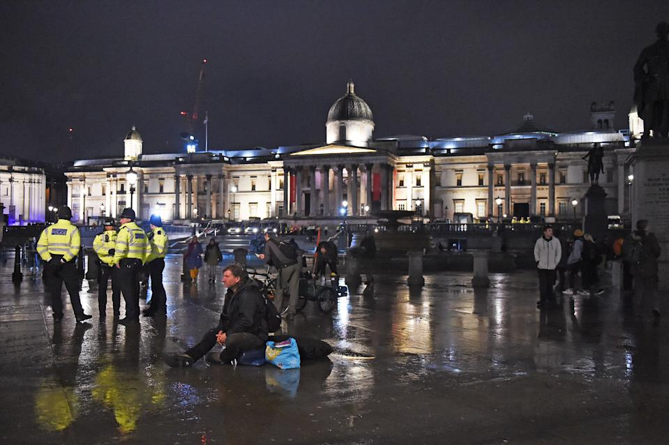 Police work to remove Extinction Rebellion protesters in Trafalgar Square, central London. (Photo by David Mirzoeff/PA Images via Getty Images)