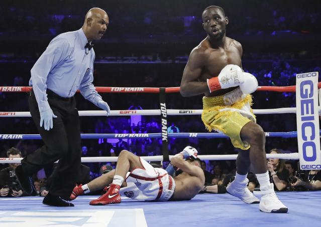 Terence Crawford, right, reacts after knocking down England's Amir Khan during the first round of a WBO world welterweight championship boxing match Sunday, April 21, 2019, in New York. Crawford won the fight. (AP Photo/Frank Franklin II)
