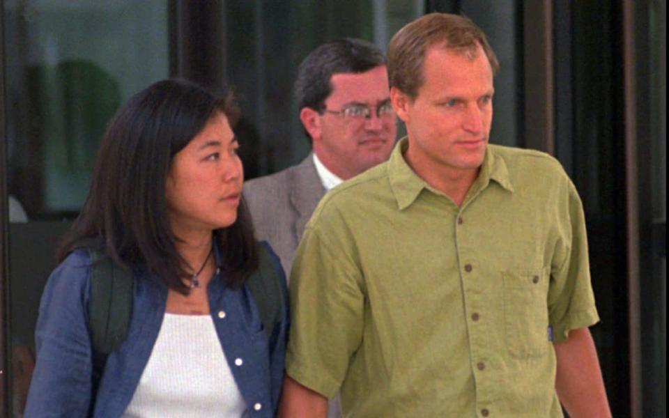 Woody Harrelson, with his wife Laura Louie, leaving a hearing for his father in Denver, 1998 - AP