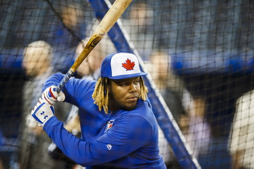 Toronto Blue Jays rookie Vladimir Guerrero Jr. takes batting practice before his major league debut against the Oakland Athletics in a baseball game in Toronto, Friday April 26, 2019. (Mark Blinch/The Canadian Press via AP)