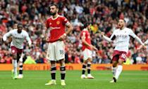 Bruno Fernandes (centre)missed a stoppage time penalty in Manchester United's 1-0 defeat to Aston Villa (AFP/Paul ELLIS)
