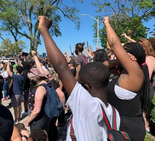Fists in the air during a moment of silence at the Black Lives Matter rally on Windsor's Riverfront in June 2020.