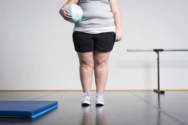 Girl with overweight in gym