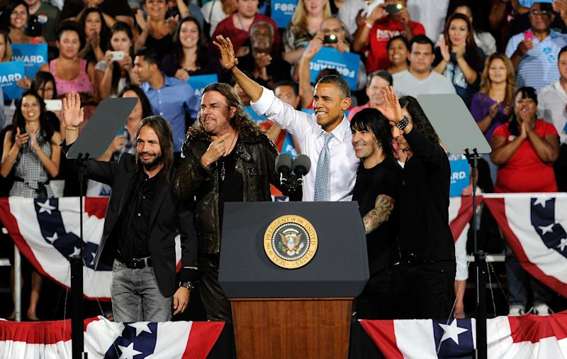 President Barack Obama, center, appears with the musical group Mana at campaign event at Desert Pines High School on Sunday, Sept. 30, 2012 in Las Vegas. Obama is spending three days in Henderson, Nevada to prepare for the first presidential debate on Oct. 3 in Denver against GOP challenger Mitt Romney. (AP Photo/David Becker)