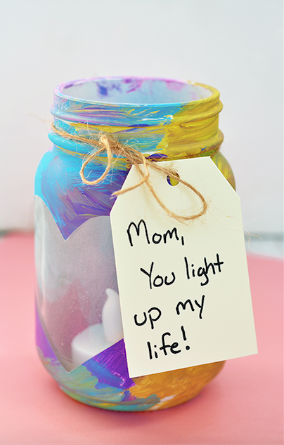 """<p>Remind Mom she's the light of everyone's life with a Mason jar votive. Kids can get creative and paint the inside however they please and a battery-operated """"candle"""" is safe for them to handle.</p><p><strong>Get the tutorial at <a href=""""http://www.iheartartsncrafts.com/mothers-day-mason-jar-votives/?utm_content=bufferdbc6e&utm_medium=social&utm_source=pinterest.com&utm_campaign=buffer"""" rel=""""nofollow noopener"""" target=""""_blank"""" data-ylk=""""slk:I Heart Arts n Crafts"""" class=""""link rapid-noclick-resp"""">I Heart Arts n Crafts</a>.</strong></p><p><strong>What you'll need: </strong><em>Mason jars ($7 for 2-pack, <a href=""""https://www.amazon.com/Ball-Pint-Jar-Regular-Mouth/dp/B01NBMPHYV"""" rel=""""nofollow noopener"""" target=""""_blank"""" data-ylk=""""slk:amazon.com"""" class=""""link rapid-noclick-resp"""">amazon.com</a>); </em><em>flameless tea light candles ($11 for 24, <a href=""""https://www.amazon.com/Instapark-Flameless-Candles-Realistic-Tealights/dp/B0064RFHHO"""" rel=""""nofollow noopener"""" target=""""_blank"""" data-ylk=""""slk:amazon.com"""" class=""""link rapid-noclick-resp"""">amazon.com</a>)</em><br></p>"""