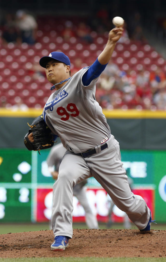 Los Angeles Dodgers starting pitcher Hyun-Jin Ryu throws against the Cincinnati Reds during the first inning of a baseball game, Wednesday, June 11, 2014, in Cincinnati. (AP Photo/David Kohl)