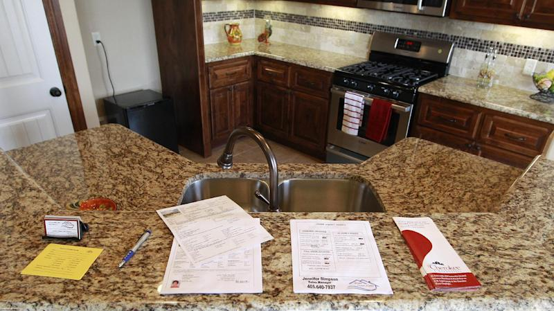 In this Sept. 21, 2012, photo, flyers are stacked on the granite counter of a new home for sale in Oklahoma City. U.S. sales of new homes jumped in September to the highest level in more than two years, further evidence of a sustained housing recovery that could help lift the lackluster economy. The Commerce Department said Wednesday, Oct. 24, 2012, that new home sales rose 5.7 percent in September to a seasonally adjusted annual rate of 389,000. That's up from a rate of 368,000 in August and the highest rate since April 2010, when a federal homebuyer tax credit inflated sales. (AP Photo/Sue Ogrocki)