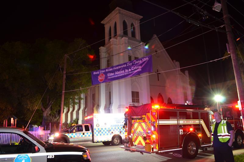 Police, ambulance and fire crews are pictured outside the Emanuel African Methodist Episcopal Church following a shooting incident in Charleston, South Carolina in this June 17, 2014. (Photo: Charleston Police Department/Handout via Reuters)