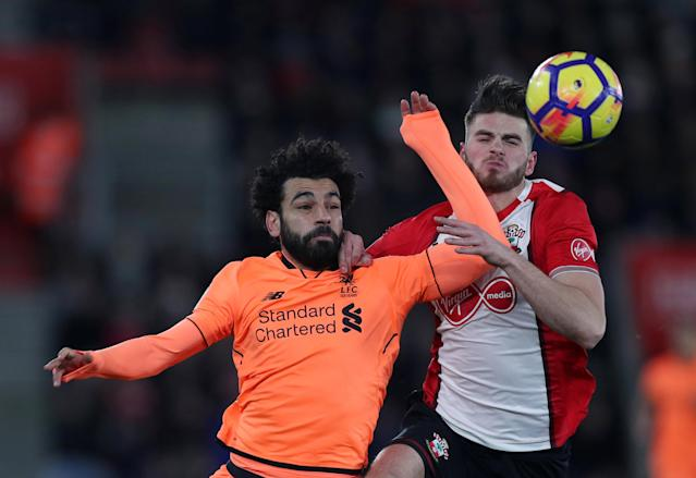 "Soccer Football - Premier League - Southampton vs Liverpool - St Mary's Stadium, Southampton, Britain - February 11, 2018 Liverpool's Mohamed Salah in action with Southampton's Wesley Hoedt Action Images via Reuters/Peter Cziborra EDITORIAL USE ONLY. No use with unauthorized audio, video, data, fixture lists, club/league logos or ""live"" services. Online in-match use limited to 75 images, no video emulation. No use in betting, games or single club/league/player publications. Please contact your account representative for further details."