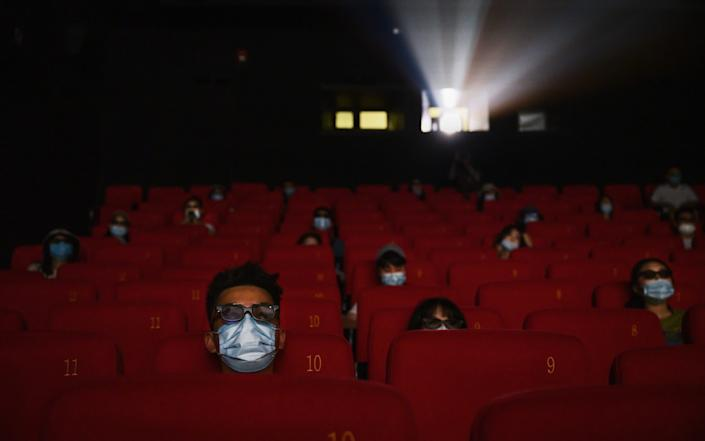 Masks and social distancing are a must in Beijing's cinemas - GETTY IMAGES