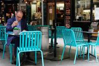A man dines at a cafe after coronavirus disease restrictions were eased in Melbourne