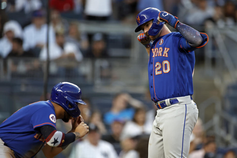 New York Mets' Pete Alonso (20) celebrates after hitting a two-run home run with Dominic Smith during the fourth inning of the second baseball game of a doubleheader against the New York Yankees on Sunday, July 4, 2021, in New York. (AP Photo/Adam Hunger)