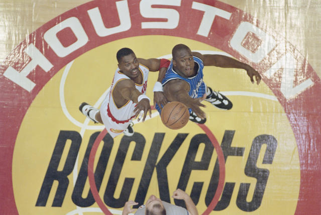 Hakeem Olajuwon and Shaquille O'Neal jumped center in the 1995 NBA Finals. (Getty Images)