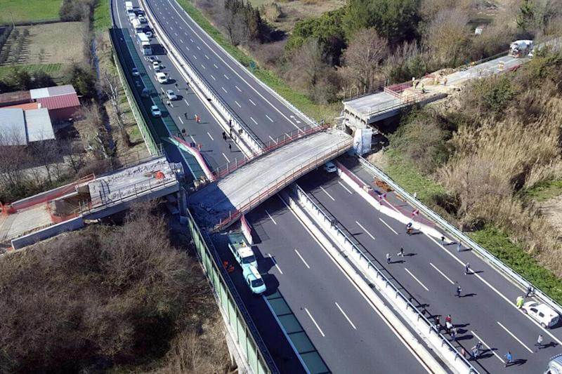 A bridge that collapsed onto the A14 motorway near the central Italian city of Ancona: EPA