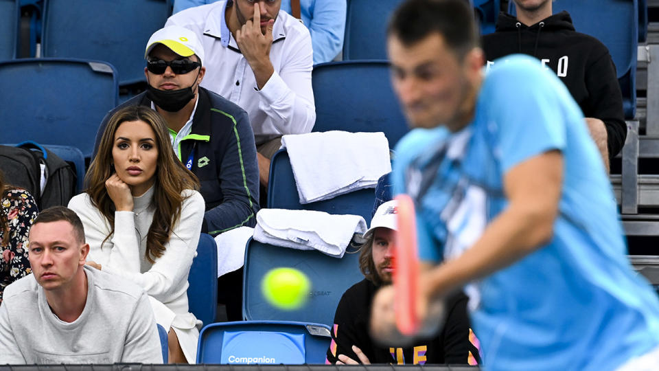 Vanessa Sierra, pictured here watching Bernard Tomic against Yuichi Sugita at the Australian Open.