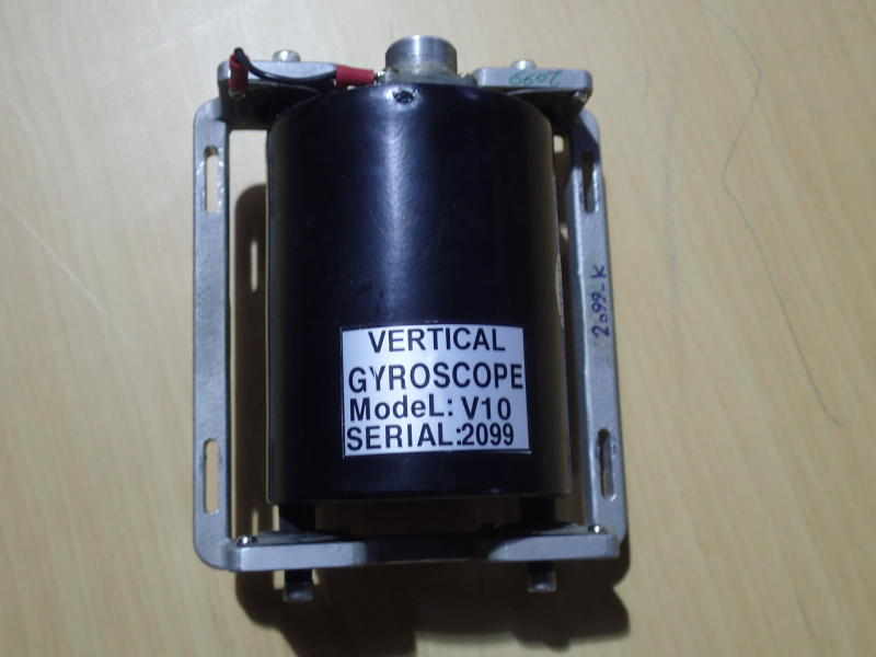In this February 2017 photograph provided by Conflict Armament Research, a gyroscope recovered from a Qasef-1 drone is displayed in Abu Dhabi, United Arab Emirates. Such gyroscopes, a small instrument within drones that targeted the heart of Saudi Arabia's oil industry and those in the arsenal of Yemen's Houthi rebels, match components recovered in downed Iranian drones in Afghanistan and Iraq, two reports said. Conflict Armament Research said in a report released on Wednesday, Feb. 19, 2020, that these gyroscopes within the drones have only been found inside those manufactured by Iran. That follows a recently released United Nations report that says its experts saw a similar gyroscope from an Iranian drone and in a shipment of cruise missiles seized in the Arabian Sea bound for Yemen. (Conflict Armament Research via AP)
